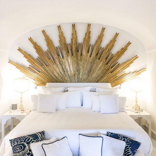 A crown bed at Villa TreVille hotel in Positano.