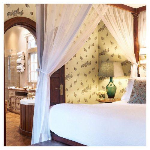 Canopy bed at Giraffe Manor in Nairobi
