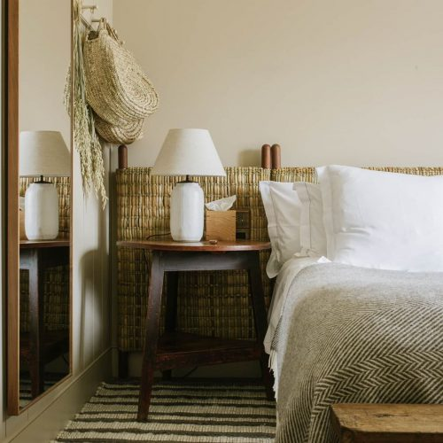Hotel bed at Heckfield Place, England.