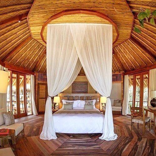 Hotel bed at Nihi Sumba, Indonesia.