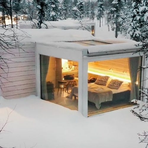 Hotel room in the snow at the Northern Lights Ranch in Finland.