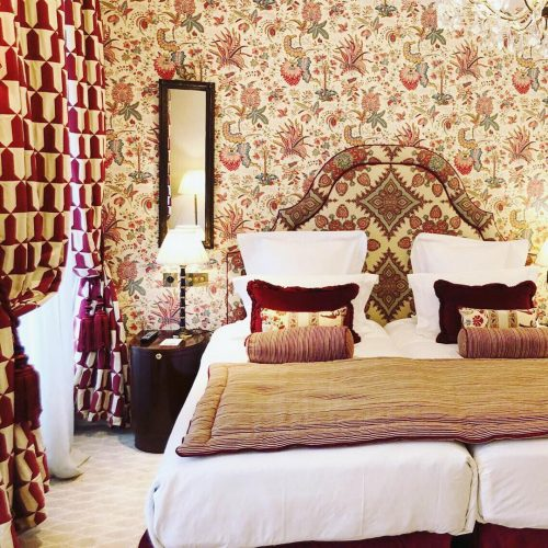 A patterned hotel bed at Relais Christine in Paris.